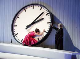 Violetta collapses on the ever-present clock, observed by Death