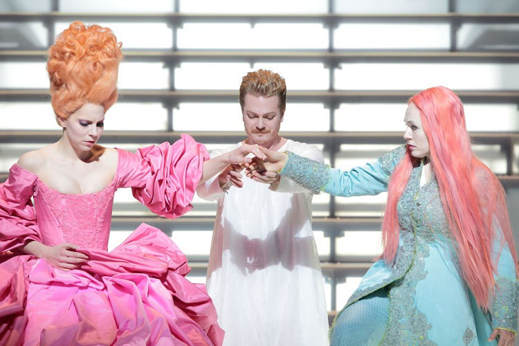 Act I: Servilia (left) and Annio (right), with Tito in the center. Note Annio's wig and gender-ambiguous costume. Also note Servilia's outrageous hair and hoop skirt.
