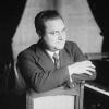 Beniamino Gigli at the piano